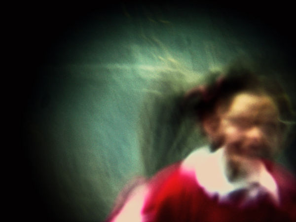 a child running past my camera with binocular