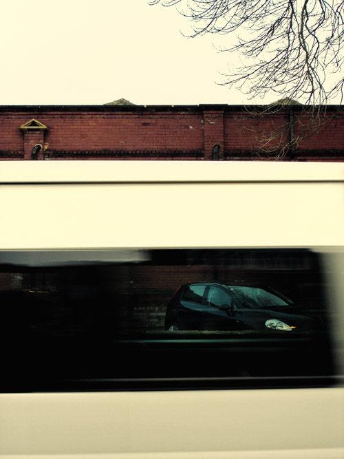 a van swoosh by a street