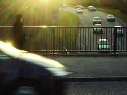 highway,city road,people,mobile phone and car