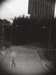 a woman walking across a street