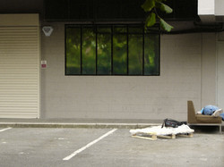 teenager lying face down on a abandoned couch