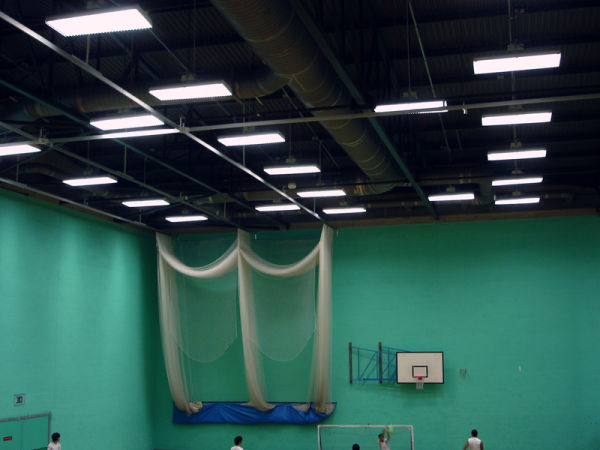 student of leeds uni playing futsal in sport hall