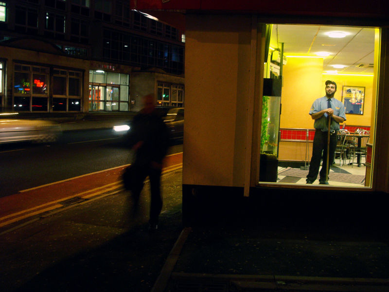 worker of a fast food restaurant in Leeds pose