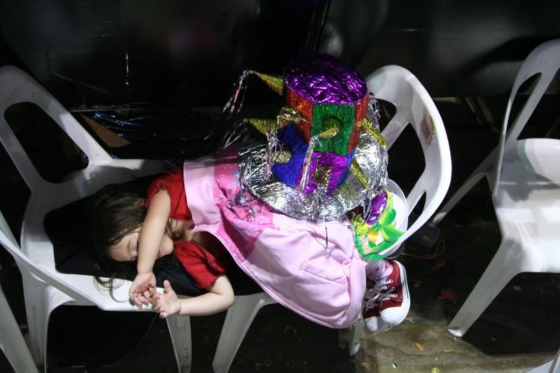 little girl asleep at carnaval