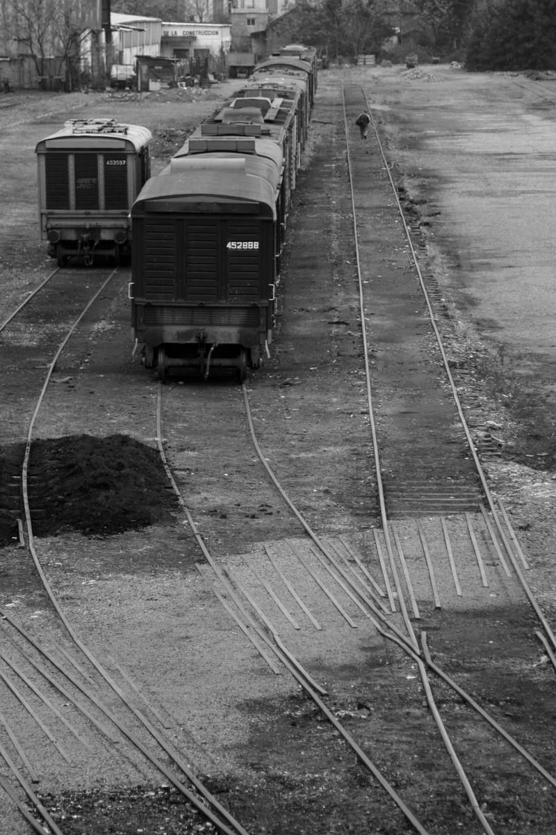 lone soul walks down railway