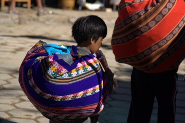 boy carrying items