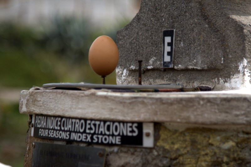 balancing an egg on the equator
