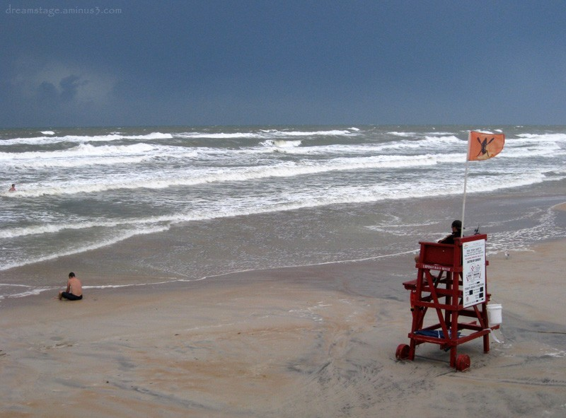lifeguard and swimmer in storm daytona