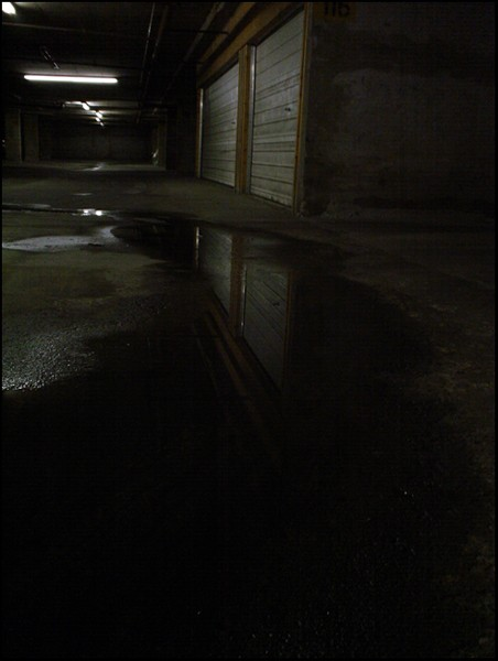 puddle in a parking garage