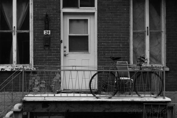 A bike parked on a porch