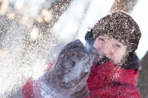 A girl playing with snow