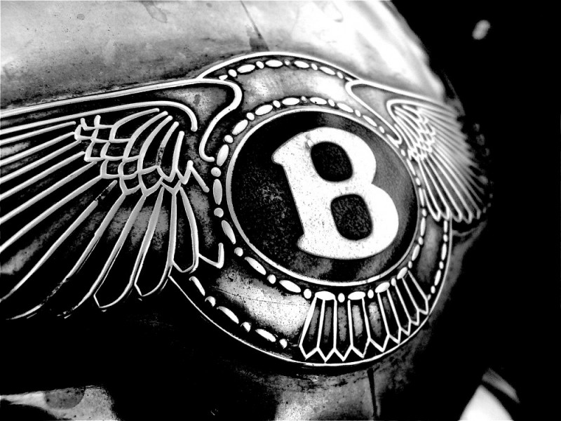 Picture of a bentley badge in black and white.