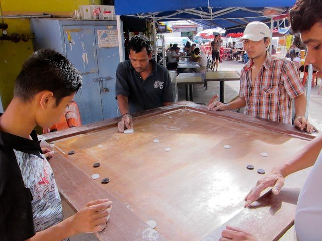Foreign workers in Singapore playing Carrom game