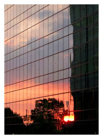 Reflection of sunset at HarbourFront office