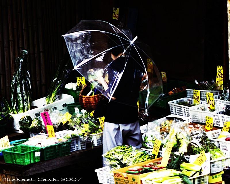Tokyo woman in roadside vegetable market