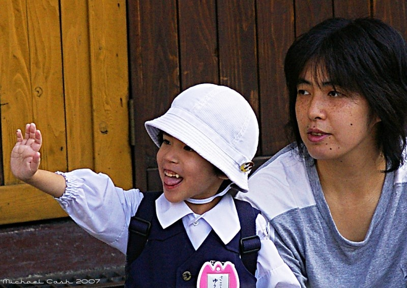 Tokyo preschooler eagerly waves at her bus