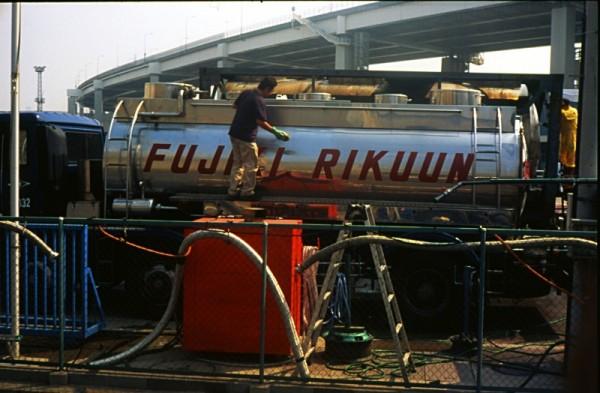 Driver washing truck in Yokohama, Japan