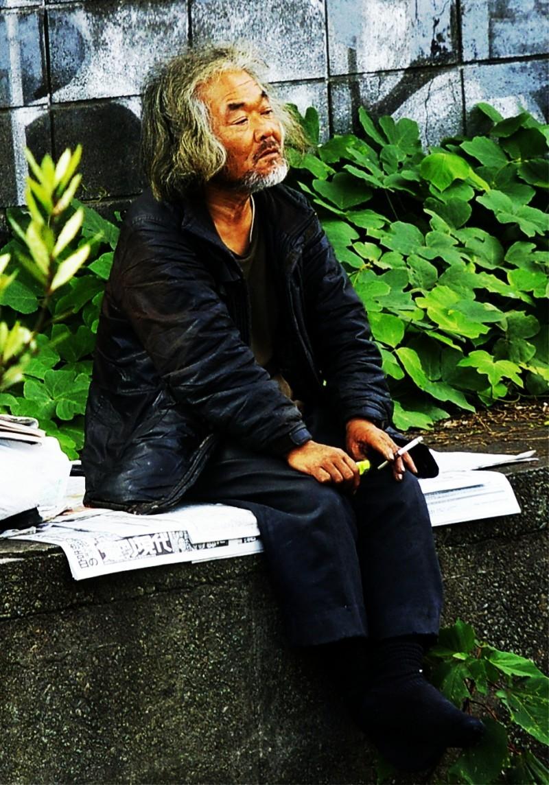 Contemplative homeless man in Tokyo