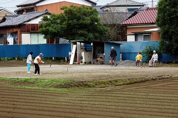 Elderly people enjoying gateball in Japan