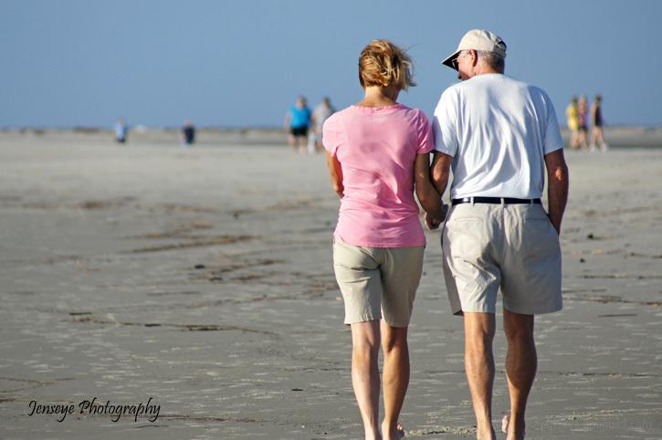 people portrait walk talk beach hands couple