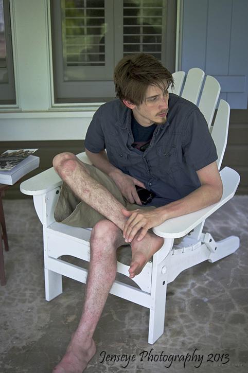 portrait man chair porch