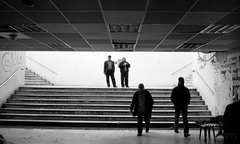 Two men stop to watch subway at Karakoy, Istanbul