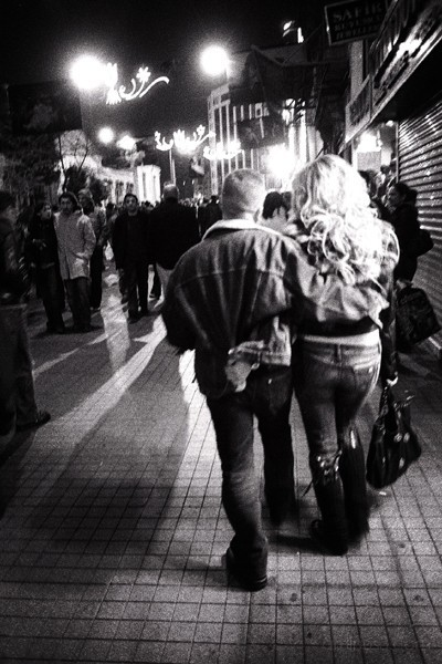 Couple walking down Istiklal at night, Istanbul