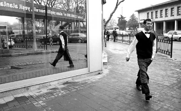 Waiter reflected in window in Besiktas