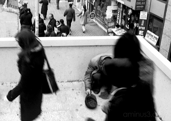 People passing a beggar in Beşiktaş, Istanbul