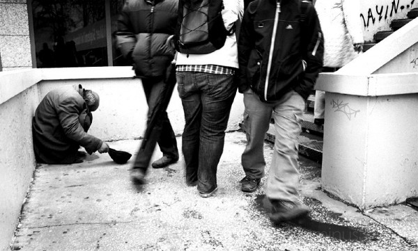 People passing beggar in Beşiktaş, Istanbul.