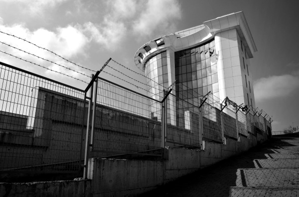 newbuild office block fenced by barbed wire