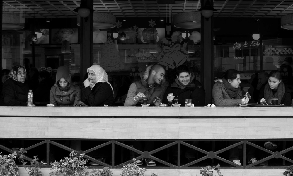 three groups of people at cafe in kadikoy istanbul