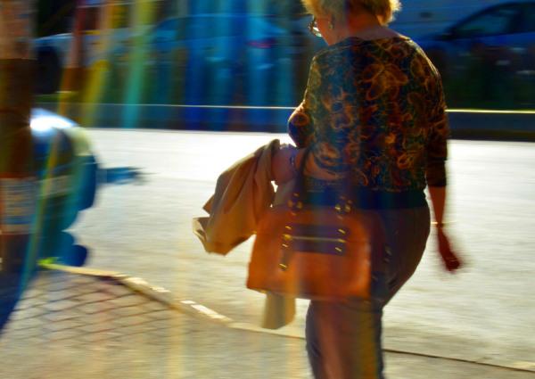 Woman with an orange handbag