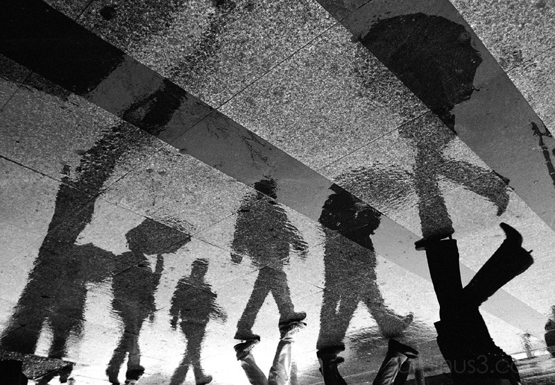 Reflections of people walking in the rain, Istanbu