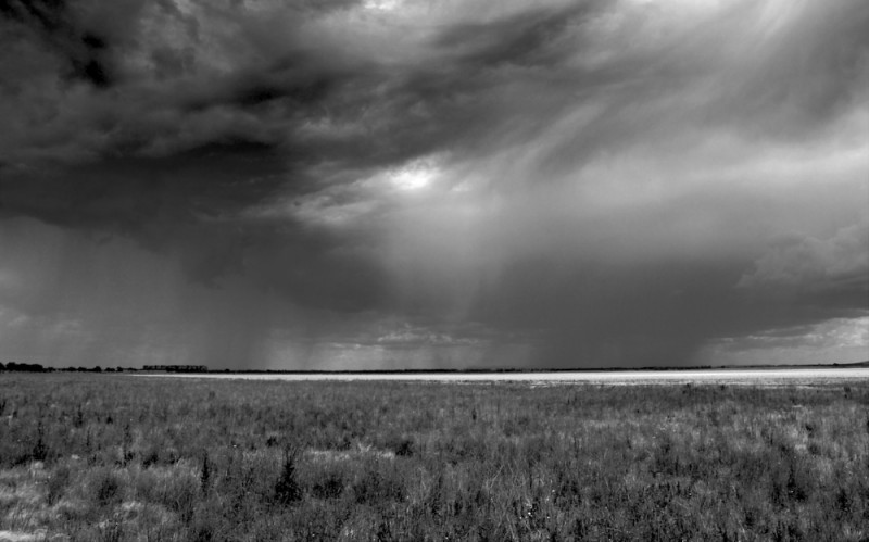Storm over dry lake bed