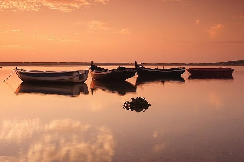 4 litle fishing boats