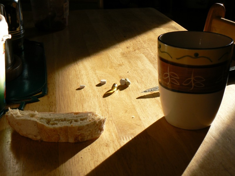 Pills with tea and bread.
