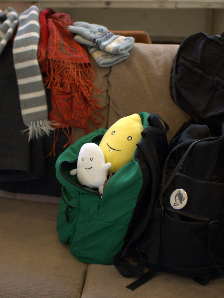 Joe the Egg and Clem Lemon in a backpack.