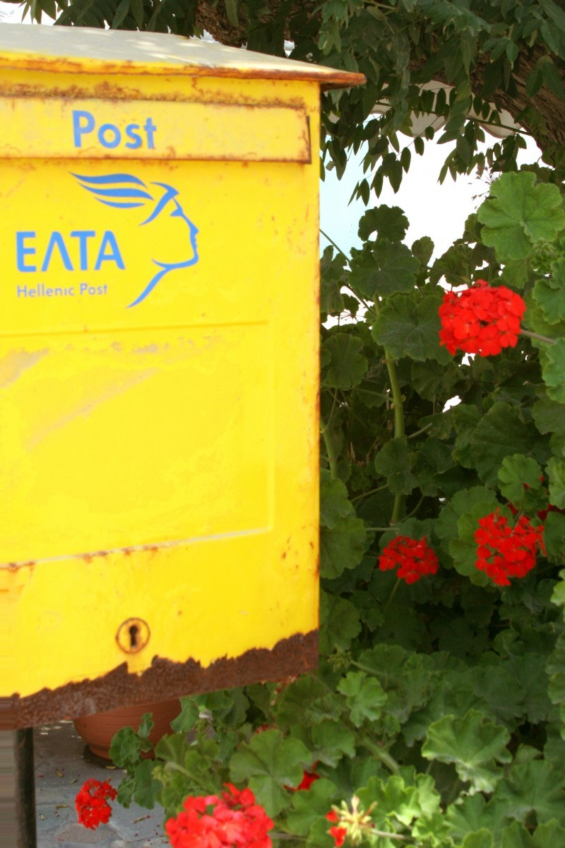 Yellow Mailbox and Red Flowers