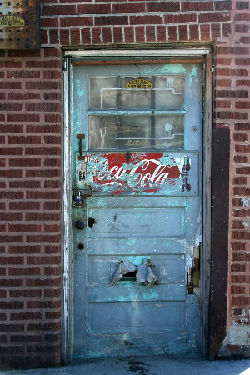 Old door with Coca Cola sign