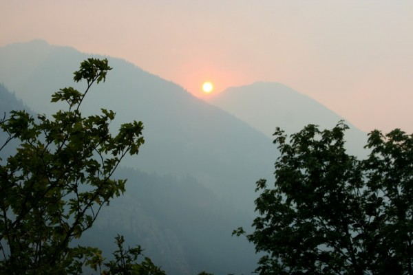 Sun setting in smoke over Lake Chelan, Washington