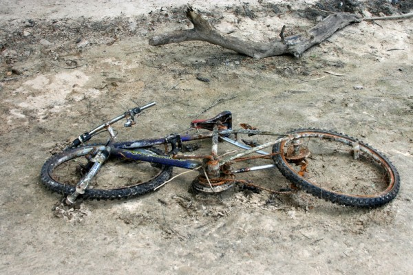 Abandoned bicycle in lake bed
