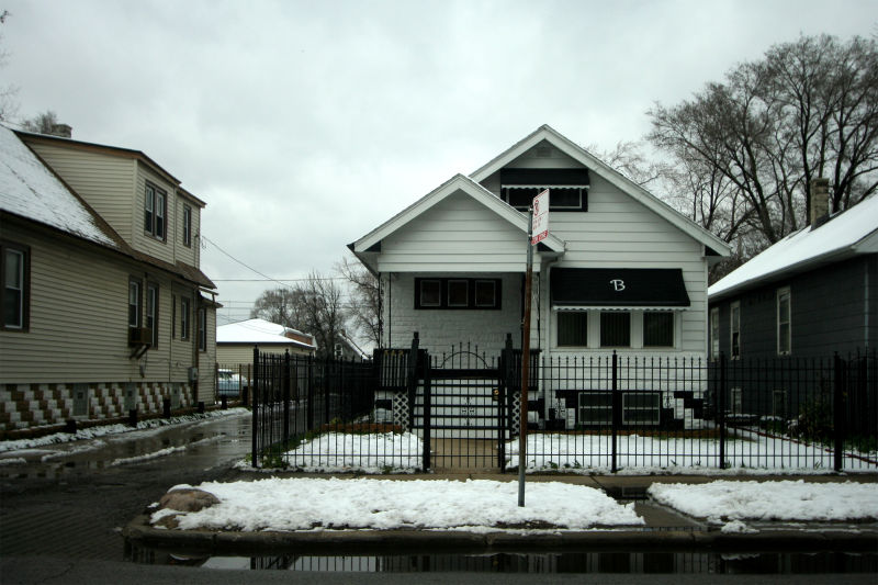 Black and white house with awning in Chicago