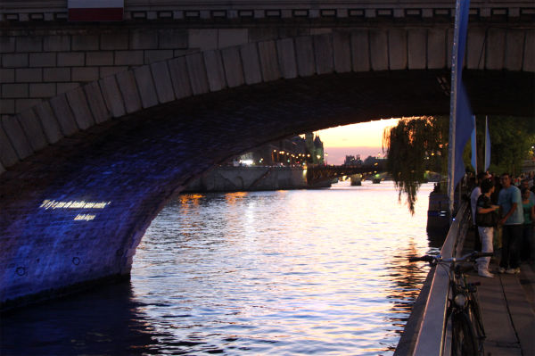 People on the bank of the Seine in Paris, France