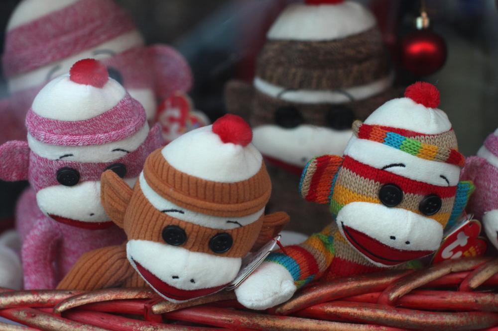 Toy Monkeys in a Window