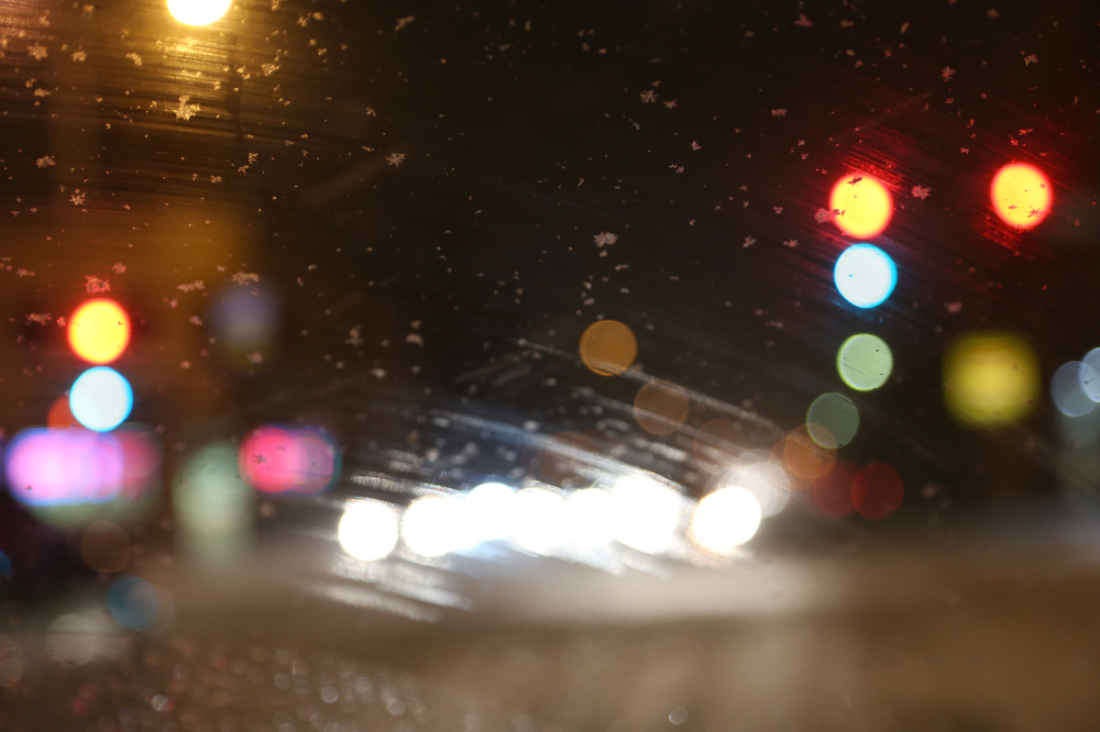 Blurred image of lights on a dark street