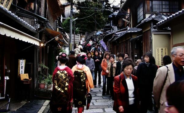 tourist sightseeing Kyoto street Japan kimono