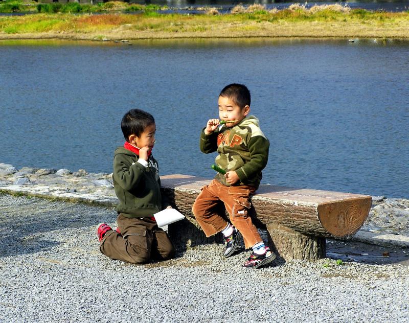 river arashiyama dango children japan kyoto