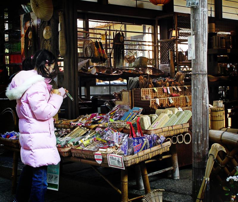 girl souvenir shop Arashiyama, Kyoto omiyage Japan