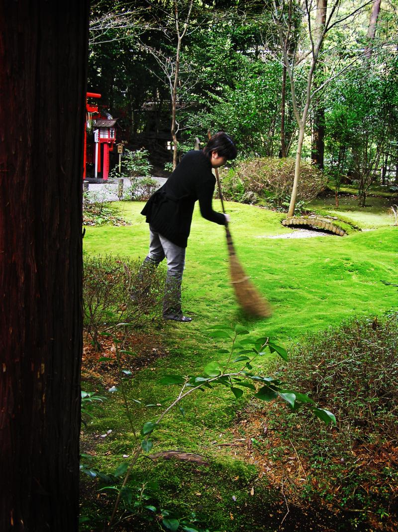 shrine sweep grass Arashiyama Kyoto Japan